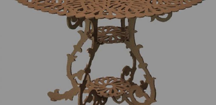 Круглый стол, украшенный резьбой
